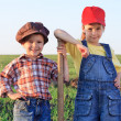 Two kids with shovel in the field — Stock Photo
