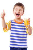 Smiling boy enjoying with glass of juice — Stock Photo