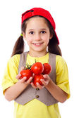 Smiling girl with tomatoes — Stock Photo