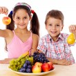 Kids with plate of fruit — Stock Photo #22595107