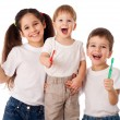 Happy family with toothbrushes — Stock Photo
