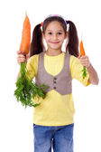 Smiling girl with two carrots — Stock Photo