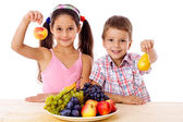 Kids with plate of fruit — Stock Photo