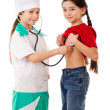 Little girl as doctor are listening a girl — Stock Photo