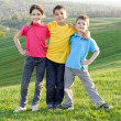 Happy kids on the hillside — Stock Photo