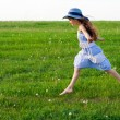 Girl runs on meadow with dandelions — Stock Photo
