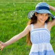 Happy girl on the green meadow — Stock Photo
