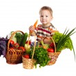Little boy with vegetables — Stock Photo