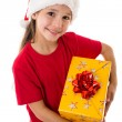 Girl in Santa hat with gift box — Stok fotoğraf