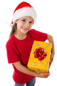 Girl in Santa hat with gift box — Stock Photo