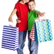 Happy kids with shopping bags — Stock Photo