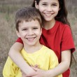 Two smiling kids standing together — Stock Photo