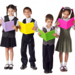 Smiling kids standing with books — Foto Stock