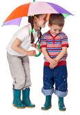 Two little children under umbrella — Stock Photo
