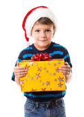 Cunning boy with gift box — Stock Photo