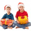 Two smiling kids with Christmas gift boxes — Stock Photo