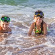 Two kids in diving masks on the sea — Stock Photo #34556017
