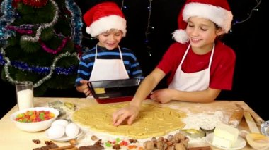 Two kids lay out the dough to baking tray — Stock Video