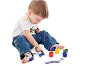 Little boy painting on the floor — Stock Photo