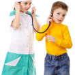 Kids playing in a doctor — Foto de Stock