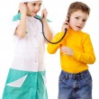 Kids playing in a doctor — Stock Photo