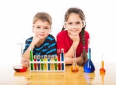 Two kids with chemical equipment — Stock Photo