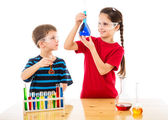 Two kids making chemical experiment — Stock Photo