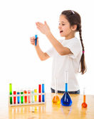Girl sniffs a chemical reagent — Stock Photo