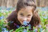 Smiling girl among the bluebells — Stock Photo