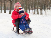 Two happy kids on the sled — Stock Photo