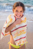 Smiling girl frozen on the beach — Stock Photo