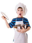 Amazing little chef opens the pot — Foto Stock
