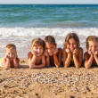 Five kids on the beach — Stock Photo