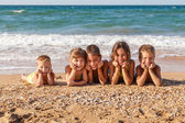 Five kids on the beach — ストック写真