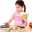 Girl at the table counts money — Stock Photo #40554859