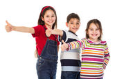 Three kids with thumbs up sign — Stock Photo