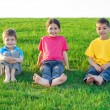 Stock Photo: Three smiling kids on the meadow
