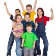 Group of kids with thumbs up sign — Stock Photo #42877665