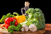 Still-life with fresh vegetables and oil — Stock Photo