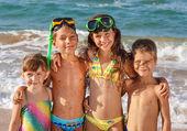 Four kids on the beach — Stock Photo