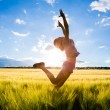 Jumping kid on the field — Stock Photo #48194891