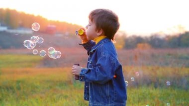 Boy with soap bubbles — Stock Video