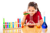 Girl making chemical experiments — Stock Photo