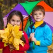 Two kids in autumn forest — Stock Photo