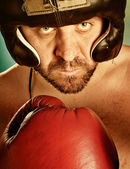 Man with boxing gloves — Stock Photo