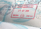 Stamps in passport — Stock Photo