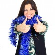 A beautiful young woman with new year decorations, on a white background, pointing his thumb up. — Stock Photo