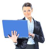 Beautiful businesswoman keeps the laptop. — Stock Photo