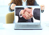 Businesswoman with tablet computer in her hand,Hand shake — Stock Photo