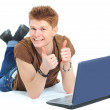 Successful happy man lying down o n floor using laptop — Stok fotoğraf